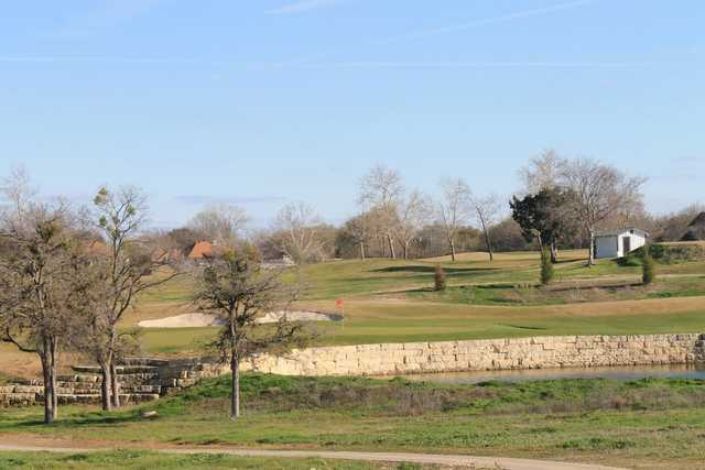 A view of a green protected by a large bunker at Sammy Baugh Golf Course from Western Texas College