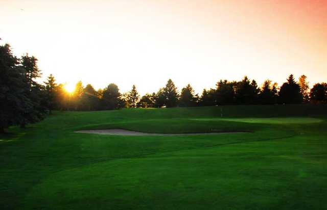 A view of a hole guarded by an undulating bunker at Brookfield Country Club
