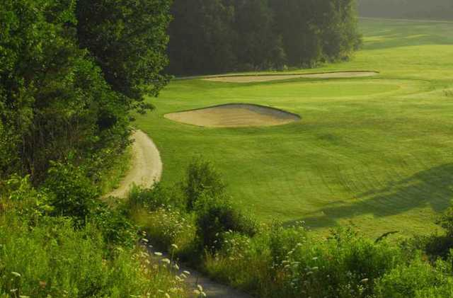 A view of a hole flanked by sand traps at Orangeville Golf Club