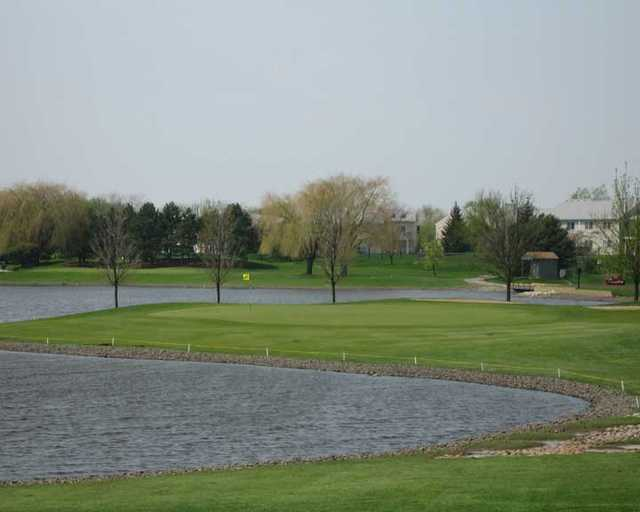 A view over the water of a green at Walnut Greens Golf Course.