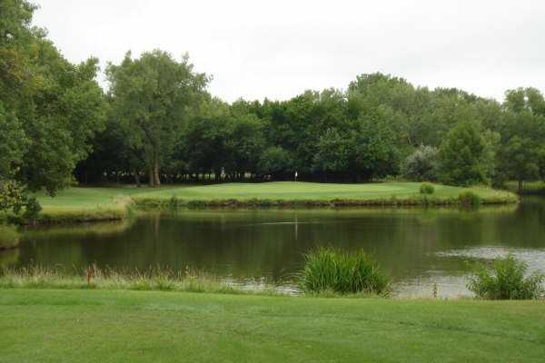 A view over the water of the 12th hole at Tallgrass Country Club
