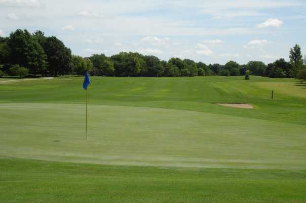 A view of a green and a fairway at Tallgrass Country Club