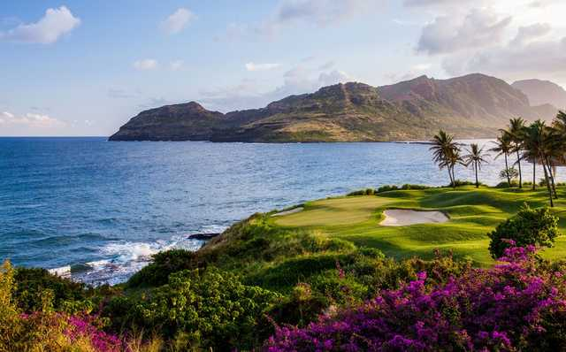 A view of a hole protected by bunkers at Kauai Lagoons Golf Club