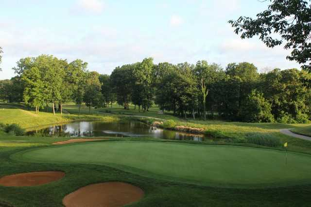 A view of a green protected by tricky sand traps at Bay Hills Golf Club