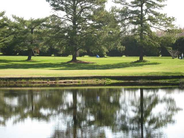 A view over the water of a hole at Blue Heron Golf Course