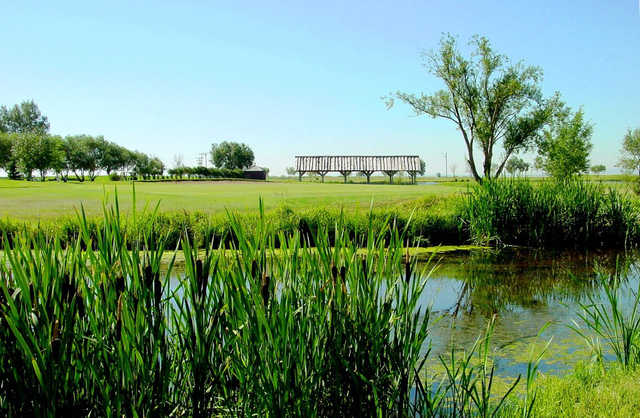 A view over a pond from the Bridges at Claresholm Golf Course