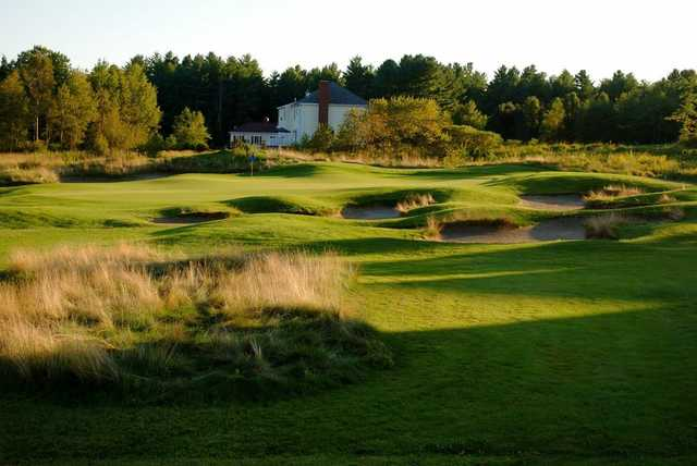 A warm sunny day view of a hole surrounded by tricky bunkers at  Falmouth Country Club
