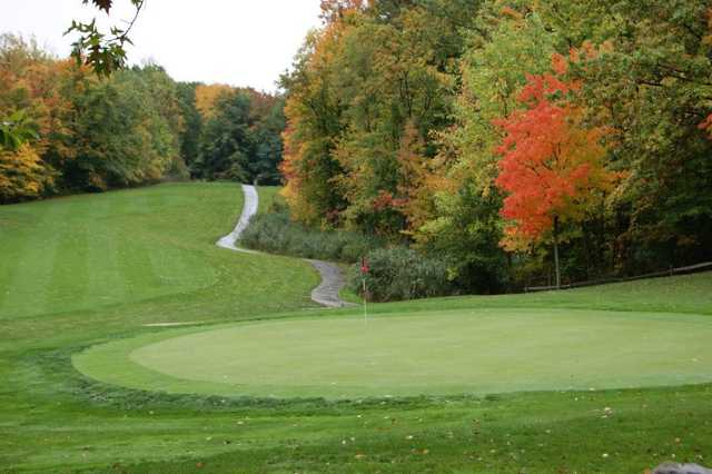 A fall view of a green at Powderhorn Golf Course
