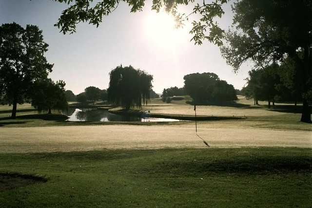 A sunny day view of a hole at Island View Golf Club