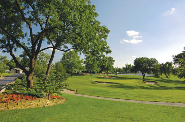 A view of a green protected by sand traps at Twin Oaks Country Club