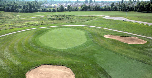 A view of a green protected by sand traps at Deer Lake Golf Club.