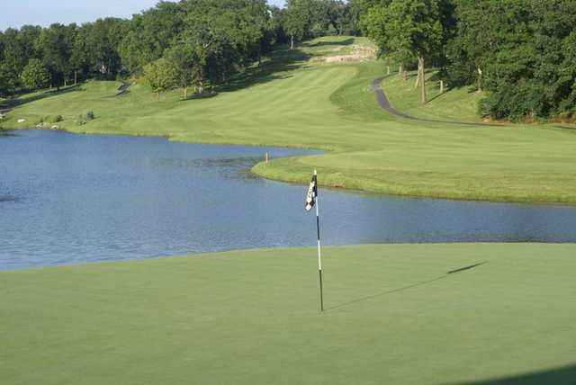A view of a green with water coming into play at Highland Springs Country Club
