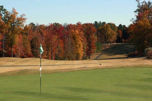 A view of a green and a fairway at Tradition Golf Club