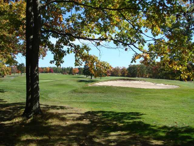 A view of a green protected by a bunker at Wilkes-Barre Golf Club