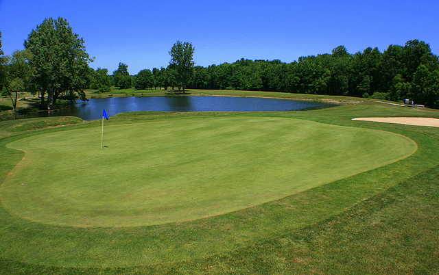 A view of a green with water coming into play at Windy Hill Golf Course