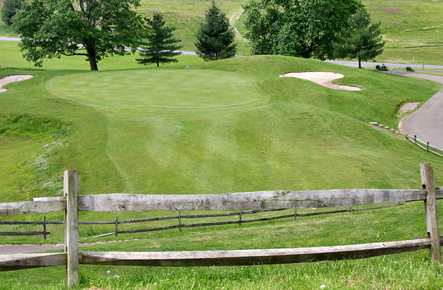 A view of a green flanked by sand traps at Fire Ridge Golf Course