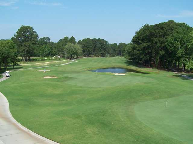 A view of a green protected by sand traps at Goldsboro Golf Course
