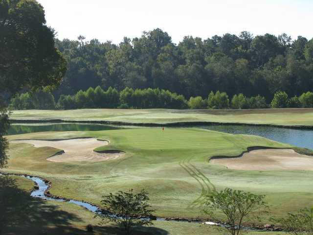 A view of a green flanked by bunkers at The Bluffs Golf and Sports Resort
