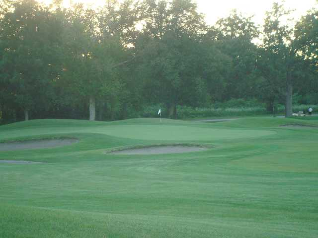A view of a hole surrounded by bunkers at Jefferson Golf Club