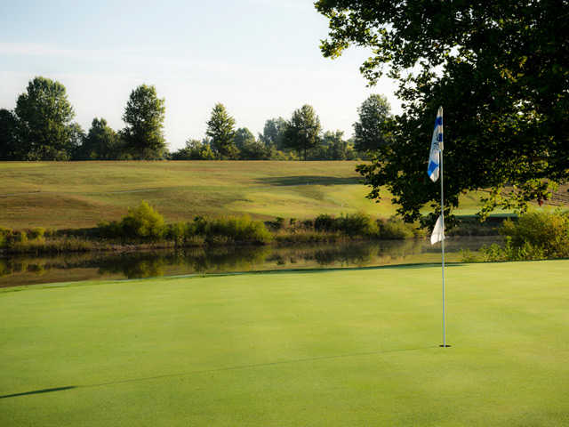 A view of a green with water coming into play at Maysville Country Club