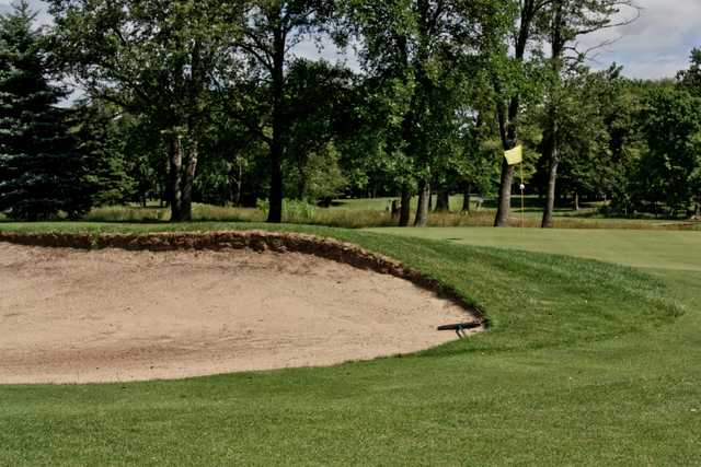 A view of a hole with a bunker on the left side at Gold from Winding Creek Golf Course