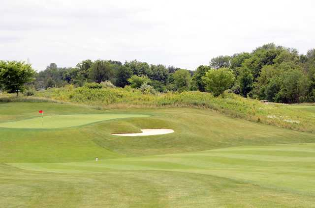 A view of a hole protected by a bunker at Legendary Run Golf Club