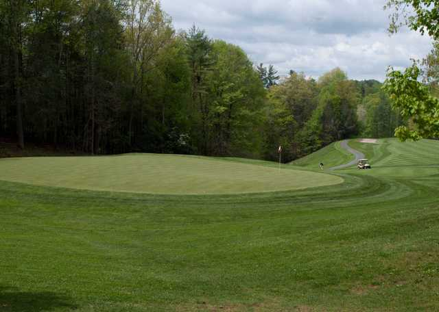 A view of a green with a narrow path on the left side at RedTail Mountain Golf Club