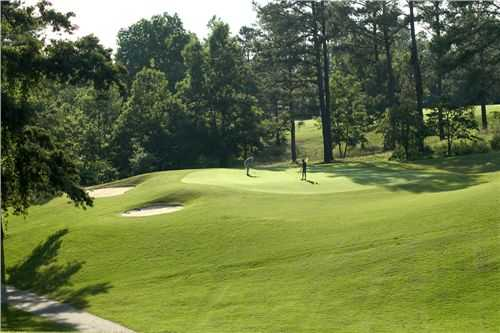 A view of a green protected by sand traps at Highland Walk from Victoria Bryant