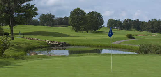 A view of a green with water coming into play at Holiday Hills Resort and Golf Club