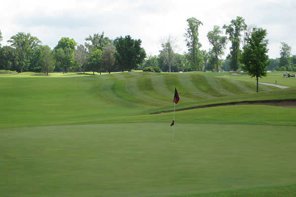 A view of a hole and a fairway at Hickory Ridge Golf Center