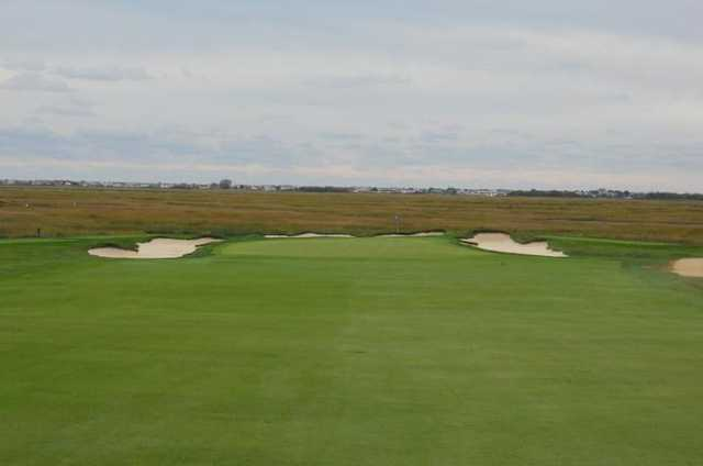 A view of a green flanked by bunkers at Lawrence Yacht & Country Club