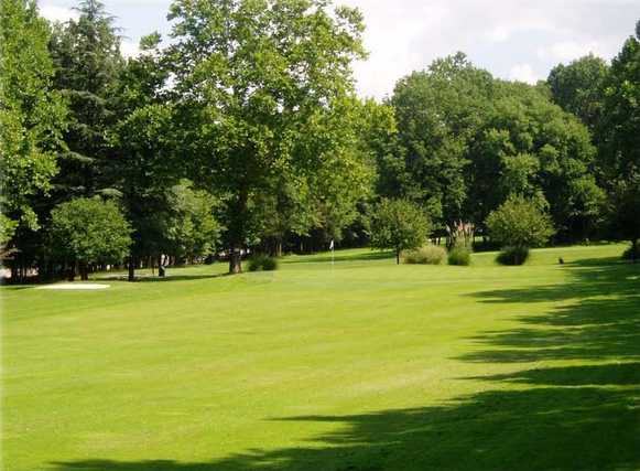 A view of a fairway and a green at Millburn Golf Course