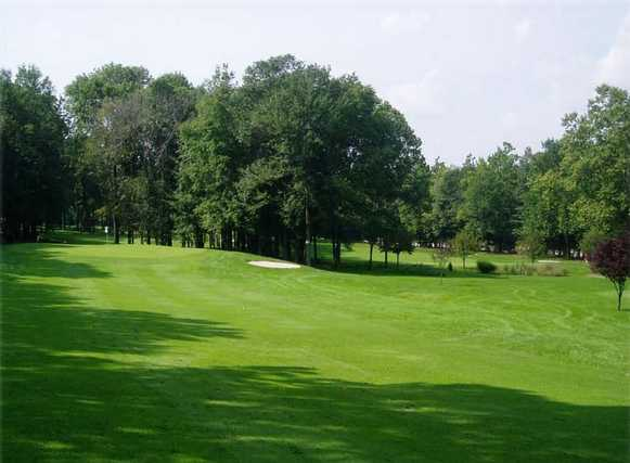 A sunny day view of a fairway at Millburn Golf Course