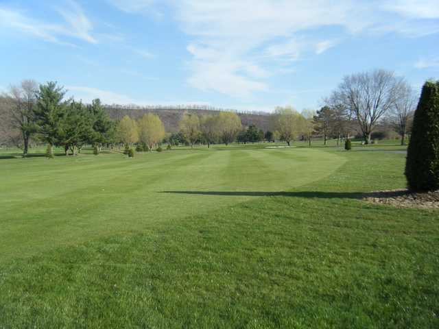 View of a fairway and green at Down River Golf Course