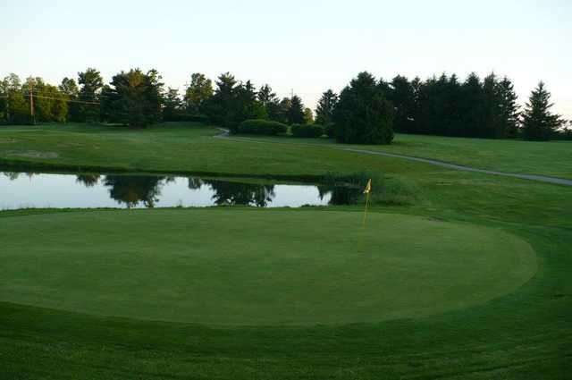 A view of a green with water coming into play at Buttermilk Falls Golf Course