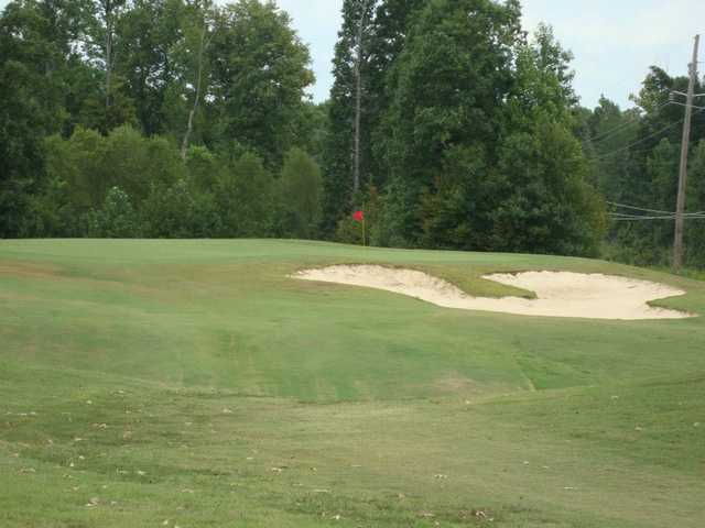 A view of a green protected by a bunker at Bent Tree Golf Club