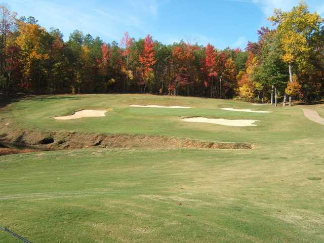 A view of a hole guarded by a collection of bunkers at St. Andrews Country Club