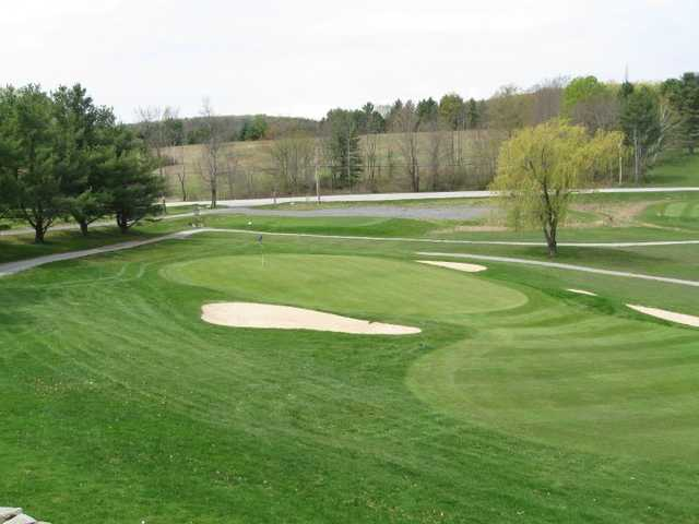 A view of green #18 flanked by sand traps at Lake St. Catherine Country Club
