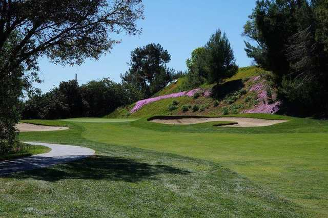 A view of a hole protected by bunkers at Pala Mesa Resort