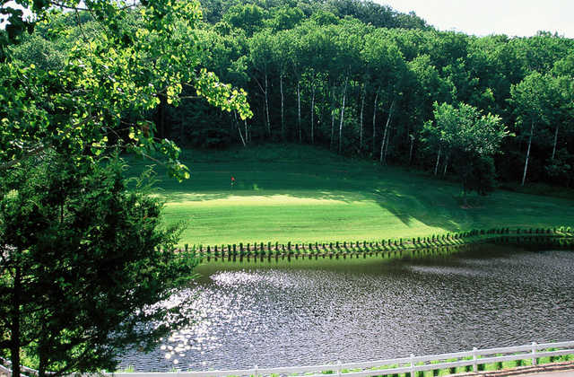 A view over a pond at Mississippi National Golf Links