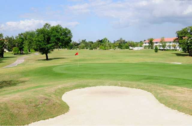 A view of a hole protected by bunkers at Colony West Country Club