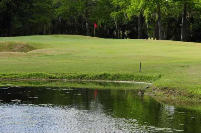 A view over the water of a  green at Colony West Country Club