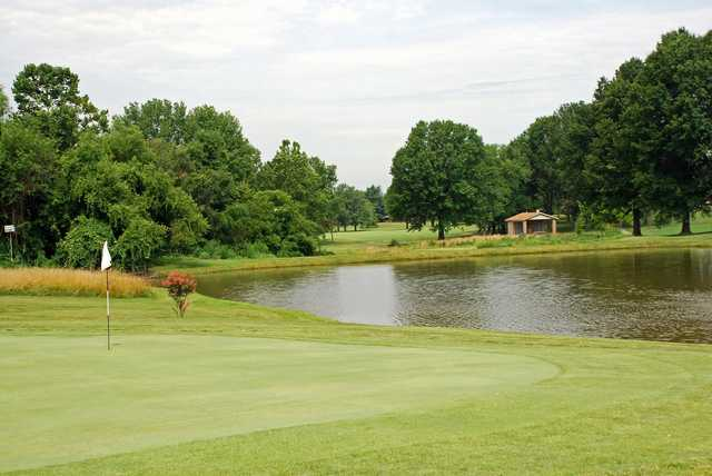 A view of a green with water coming into play at Elk Run Golf Club