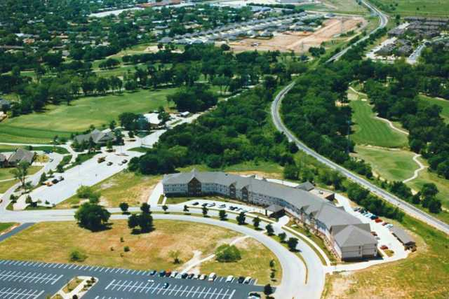 Aerial view of the clubhouse and driving range at Iron Horse Golf Course