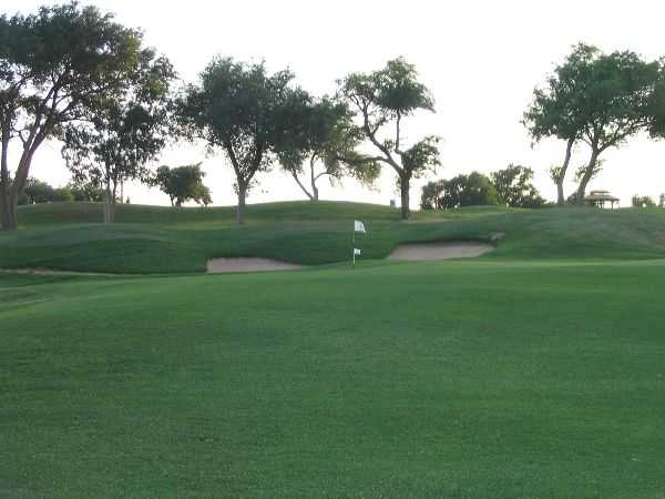 A view of a hole protected by a large bunker at Canyon from Meadowbrook Golf Complex