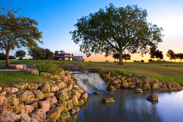 A view of the clubhouse and waterfall at Teravista Golf Club