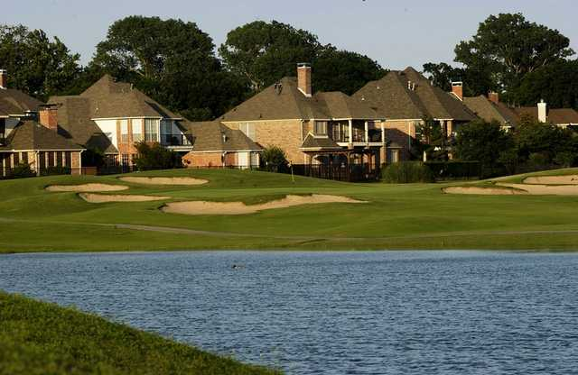 A view of a green surrounded by a collection of bunkers at Twin Creeks Golf Course