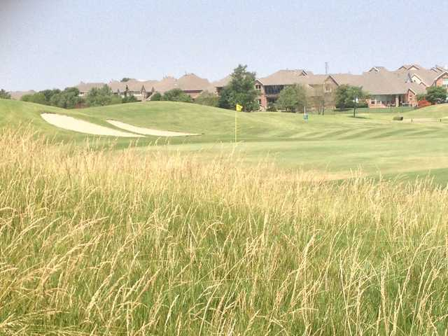 A warm day view of a hole at WestRidge Golf Course