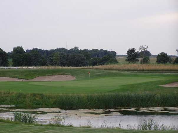 A view of a hole with water and bunkers coming into play at Whitetail Ridge Golf Club