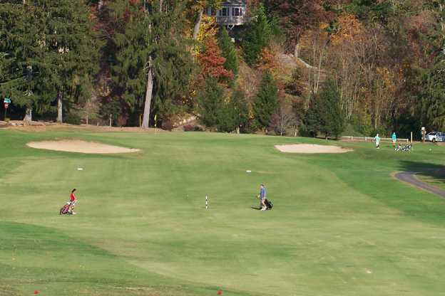 A view of a green flanked by sand traps at Asheville Golf Course